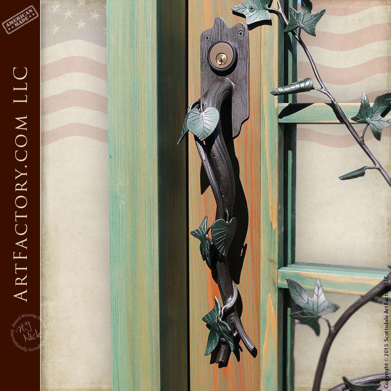 French paned glass wooden door with custom vine door handle