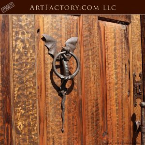 medieval style arched door with hand forged dragon door knocker