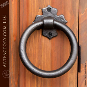 arched solid wood door with custo esutcheon door knocker