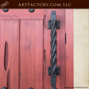 custom castle style door with rugged twisted iron door pull