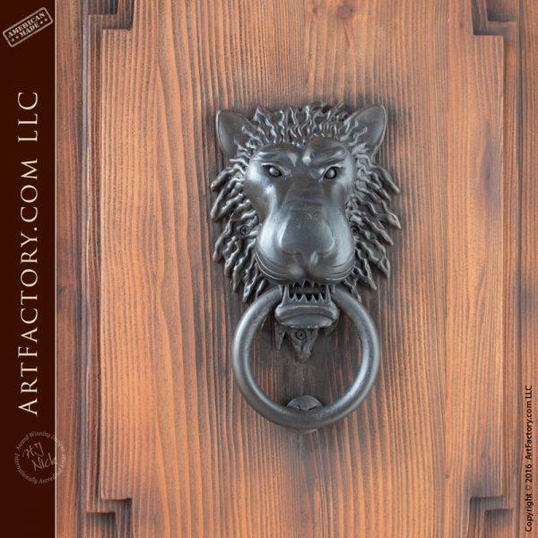 castle style double doors with lion head iron door knocker