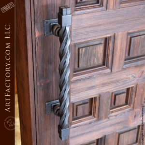 custom variable sized panel door with rugged twisted iron door pull