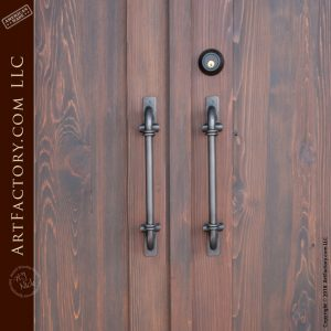 handcrafted double entrance doors with c-shaped inverted scroll door handles