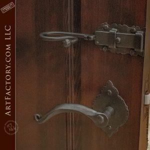 hand carved mirror door with old world door handle