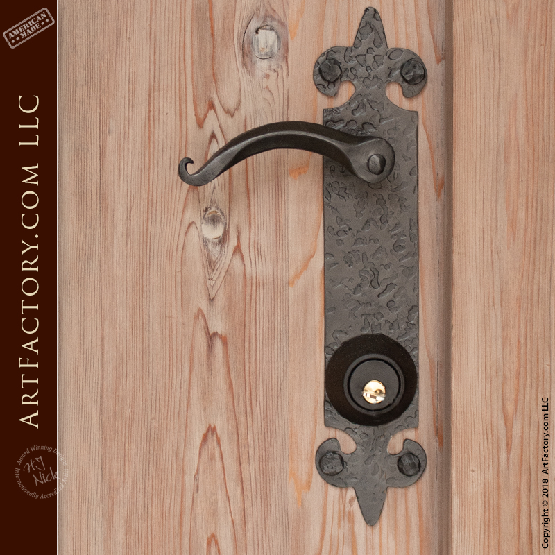 custom arched wood door with medieval lever style handles