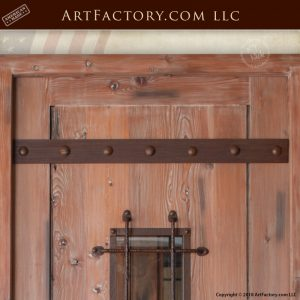 medieval fortress door with custom full span strap