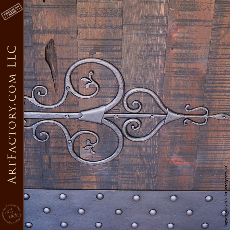 custom gothic front door with medieval Spanish hinge straps and kick plate