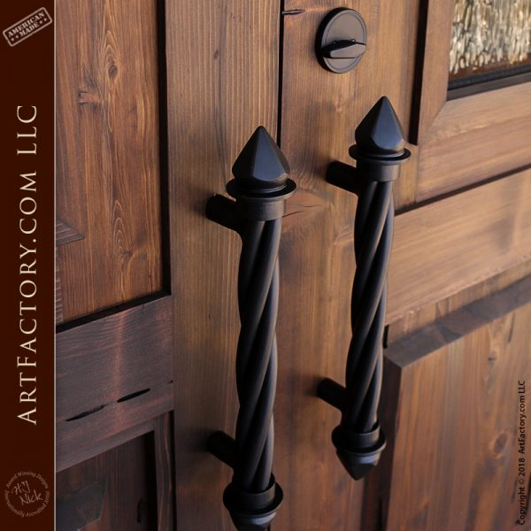 Spanish inspired double doors with spear and twist door pulls