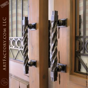 with rugged twisted iron door pulls