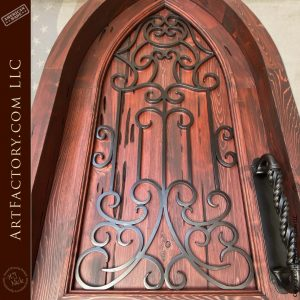 close up top of wooden cathedral door
