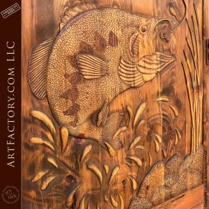 detailed wood carving of large mouth bass