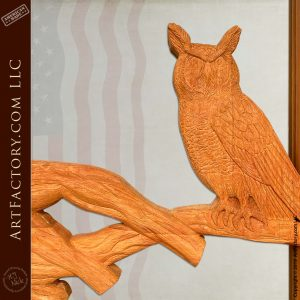 hand carved owl on tree branch