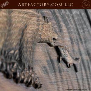 bear eating fish wood carving