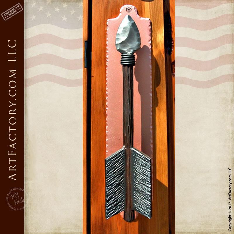 custom arrow door pull on Chief Joseph inspired hand carved door